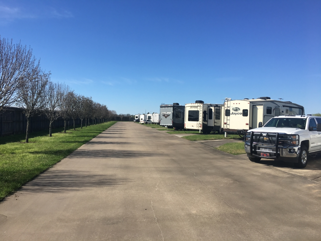 A row of RVs parked at Gulf Coast RV Resort