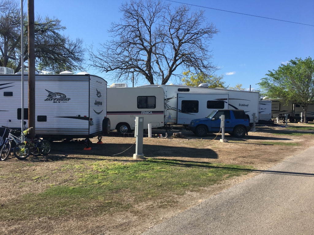 Row of RVs parked at Riverwalk RV Park in San Antonio, Texas