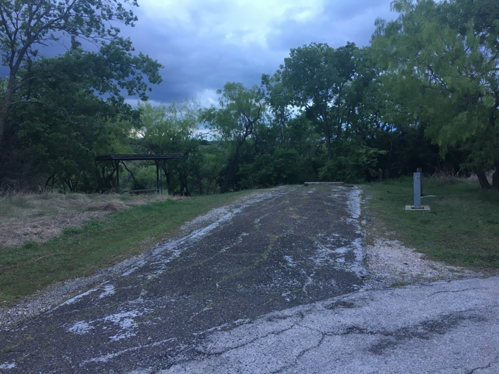 Cedar Hill campsite that is unlevel with cracked pavement.