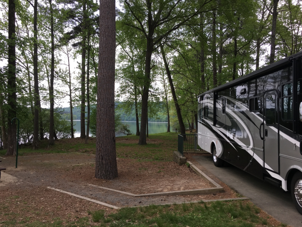 RV parked in lakeside spot at Lake Catherine State Park
