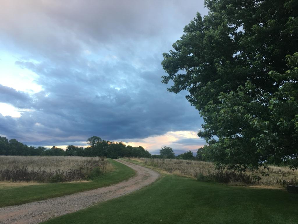 Walking trail cutting through a field at Gettysburg Farm Campground