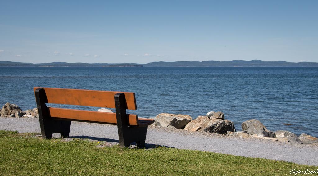 Bench in front of ocean at Kiwanis Oceanfront Camping