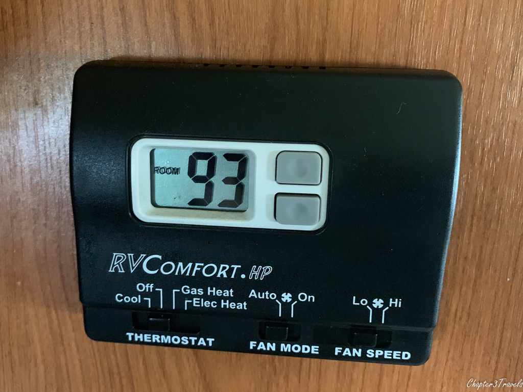 Thermostat showing 93 degree temperature